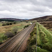 The Railroad To....in Scotland With Clouds Hanging Over The Mountains. Art Print