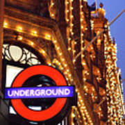 The Underground And Harrods At Night Art Print