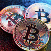 Three Bitcoin Coins In A Colorful Lighting. Art Print