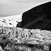 tourist couple at the end of Skaftafell glacier Vatnajokull national park in Iceland Art Print