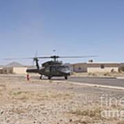 Uh-60 Black Hawk Helicopter Lands Art Print