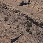 Uh-60 Black Hawk Hovers Above U.s Art Print