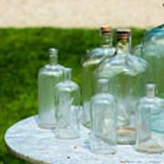 Vintage Glass Bottles On Table Art Print