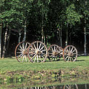 Wagon Wheels Reflecting In A Pond Art Print