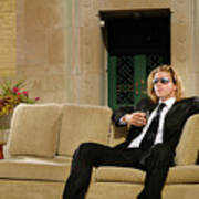 Wealthy Young Man In Suit Sitting On A Couch With A Drink On A T Art Print