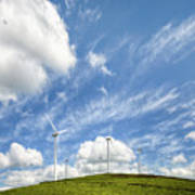 Wind Turbines On A Hill Under A Blue Sky Art Print