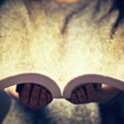 Woman Holding An Open Book Bursting With Light. Art Print