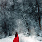Woman In Red Cape Walking In Snowy Woods Art Print