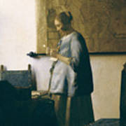 Woman Reading A Letter Print by Jan Vermeer