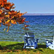 Wooden Chairs On Autumn Lake Art Print by Elena Elisseeva