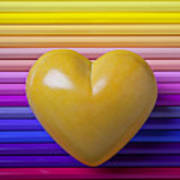 Yellow Heart On Row Of Colored Pencils Art Print by Garry Gay