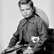 Young Cowboy Sitting Art Print