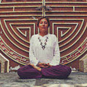 Young Woman Sitting And Meditating In A Lotus Position In Front Of A Unique Doors Art Print