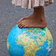 Young Woman Standing On Globe Art Print