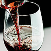 Red Wine Being Poured In A Glass Art Print