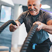 Senior Man Exercising With Ropes At The Gym. Art Print