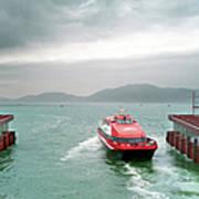 A Catamaran Ferry Docks At A Port Art Print