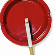 A Red Ashtray With A Burning Cigarette Art Print