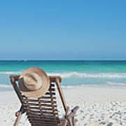 Beach Chair With A Hat On An Empty Beach Art Print