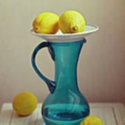 Blue Pitcher With Lemons On White Plate Art Print