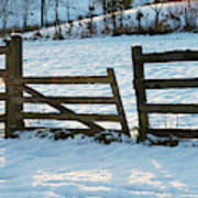Broken Fence In The Snow At Sunset Art Print