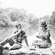 Couple Seated On Checkered Tablecloth Art Print
