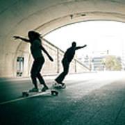 Couple Skateboarding Through Tunnel Art Print