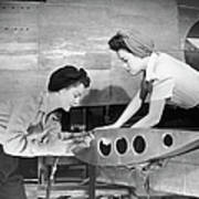 Female Workers Working On Plane Art Print