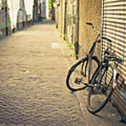 Old Abandoned Bicycle Leaning On The Art Print