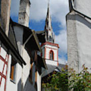 old historic church spire and houses in Ediger Germany Art Print