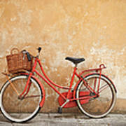 Old Red Bike Against A Yellow Wall In Art Print