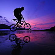 Silhouette Of A Mountain Biker On Beach Art Print