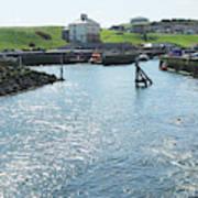 sunlight glistening on water at Eyemouth harbour Art Print
