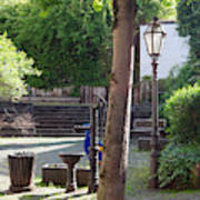 tree lamp and old water pump in Cochem Germany Art Print
