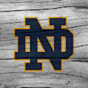 University Of Notre Dame Fighting Irish Logo On Rustic Wood Art Print