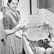 Woman Drying Dishes At Kitchen Sink Art Print