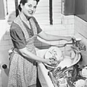 Woman Washing Dishes In Kitchen Sink Art Print
