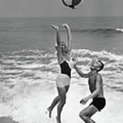 Young Couple Playing With Beach Ball At Art Print