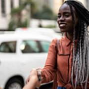 Businesswomen Shaking Hands In Meeting At City Art Print