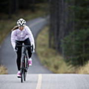 A Woman Rides Her Road Bike Along The Trans Canada Trail Bikepath Near Canmore, Alberta, Canada In The Autumn. Art Print