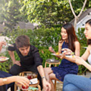 Asian Friends Enjoying Outdoor Roof Top Party Art Print