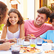 Family gathered at an outdoor restaurant to share a meal Art Print