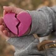 Girl holding broken heart Art Print