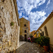 Narrow alley and old houses with plants outside in Castelmola Taormina Sicily Italy Art Print