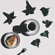 Studio Shot Of Coffee Cup And Cake Surrounded By Ivy Leaves Art Print