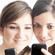 Teenage girls using cell phones Art Print