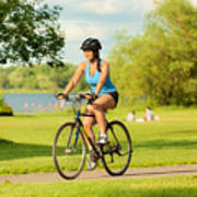 Young Healthy Woman Exercising on Bicycle in Urban City Art Print