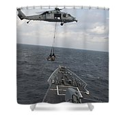 An Mh-60s Sea Hawk Helicopter Delivers Shower Curtain