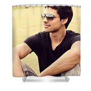 Man In Twenties Relaxing Outside On Green Grass Shower Curtain