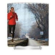 A Woman Running Near A Railroad Track Shower Curtain